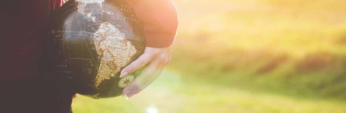 Community holding the globe