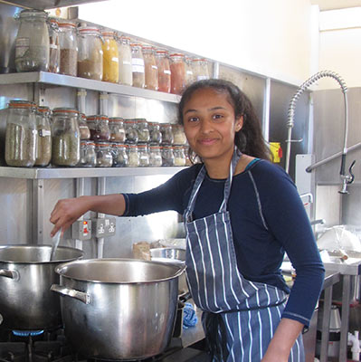 Volunteer cooking at the Dru centre